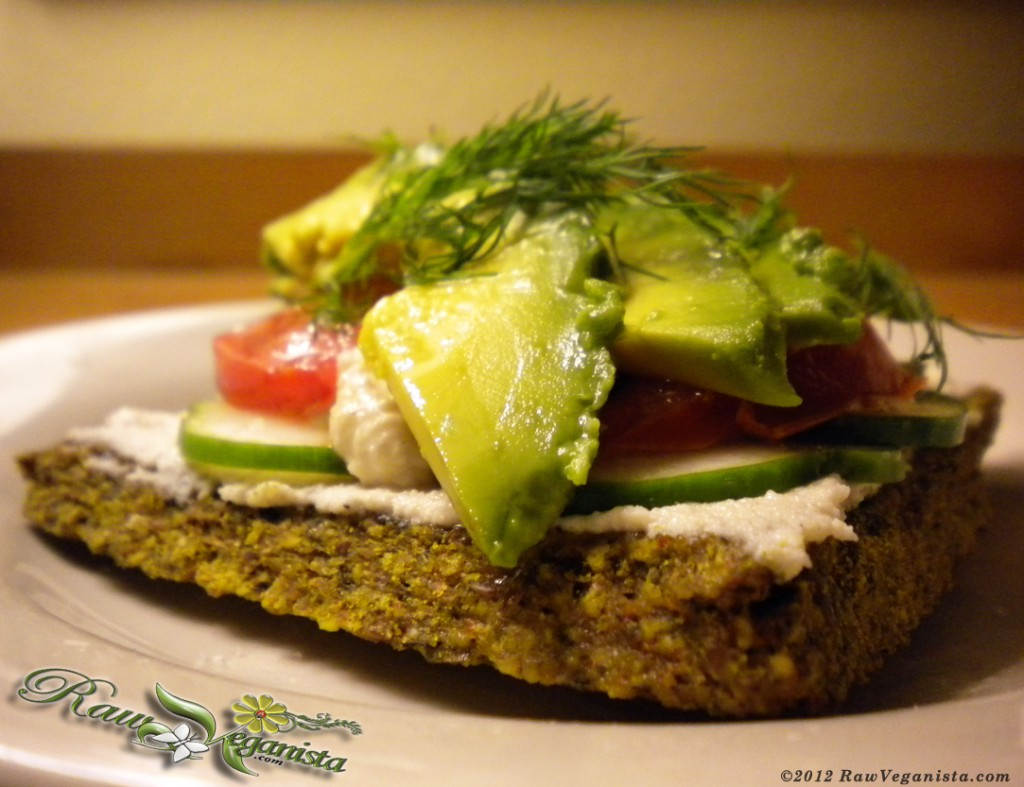 Macadamia nut hoummous open-faced sandwich on sunflower bread w/fresh seasonal produce